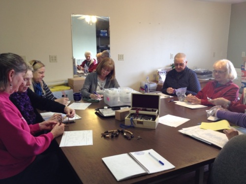 "Volunteers review jewelry donations for ""Be Jeweled"""