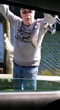 Local Fisherman Tony Thomas catching trout at Big Creek in Newport