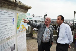 Newport Tsunami Dock Foundation board member Bob Ward points out the information displays on the Misawa dock corner section on the Newport Bayfront to Japanese Consul General Hiroshi Furusawa Monday. (Photos by Larry Coonrod)