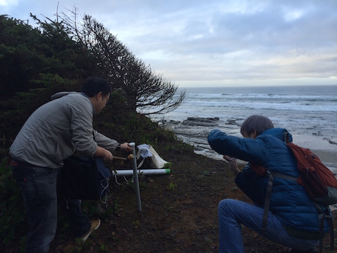 Researcher Dr. Isobe Atsuhiko and his technician test one sites soil composition for project suitability