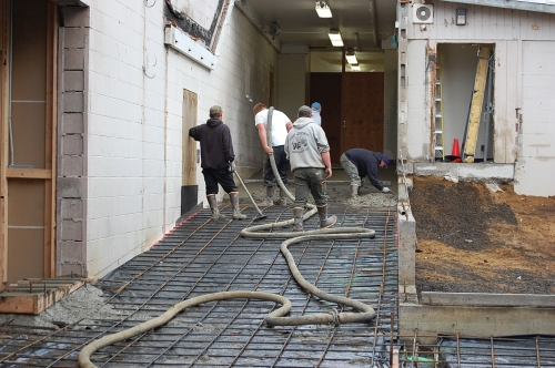 Crews from Page Concrete Construction pour concrete for the new ramps leading to two classrooms, the music building, and the cafeteria building at Taft Elementary. (courtesy photo)