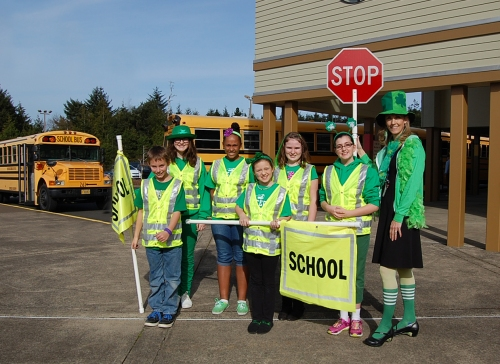 Principal Kelly Beaudry, far right, poses with members of her newly enacted Student Crossing Guard Patrol. And, no, the shamrock attire is not part of the standard patrol uniform but was worn in celebration of the school's switch to the Irish mascot.